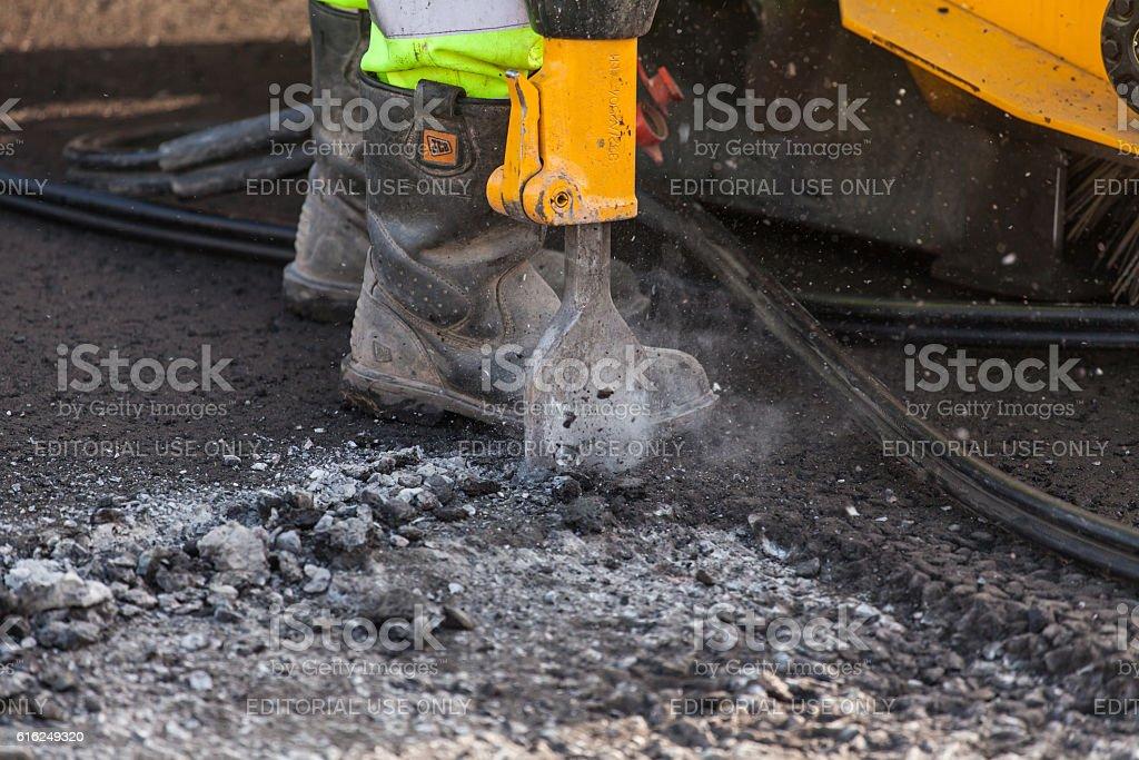 Roadworker using pneumatic drill stock photo