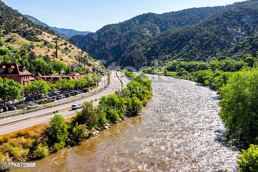 Glenwood Springs, USA - July 10, 2019: Roaring Fork Colorado river in downtown with water and highway in summer