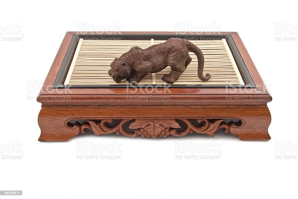 roaring tiger figurine on chinese wooden table royalty-free stock photo