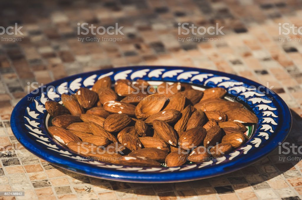 Roast Almond in white dish stock photo