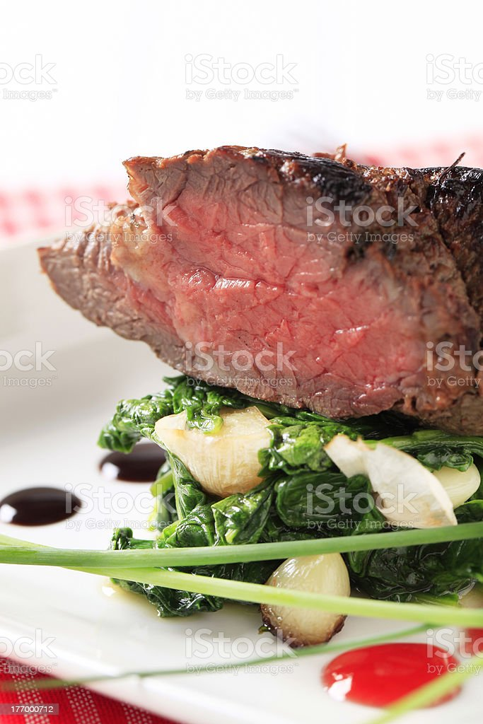 Roast beef and spinach leaves royalty-free stock photo