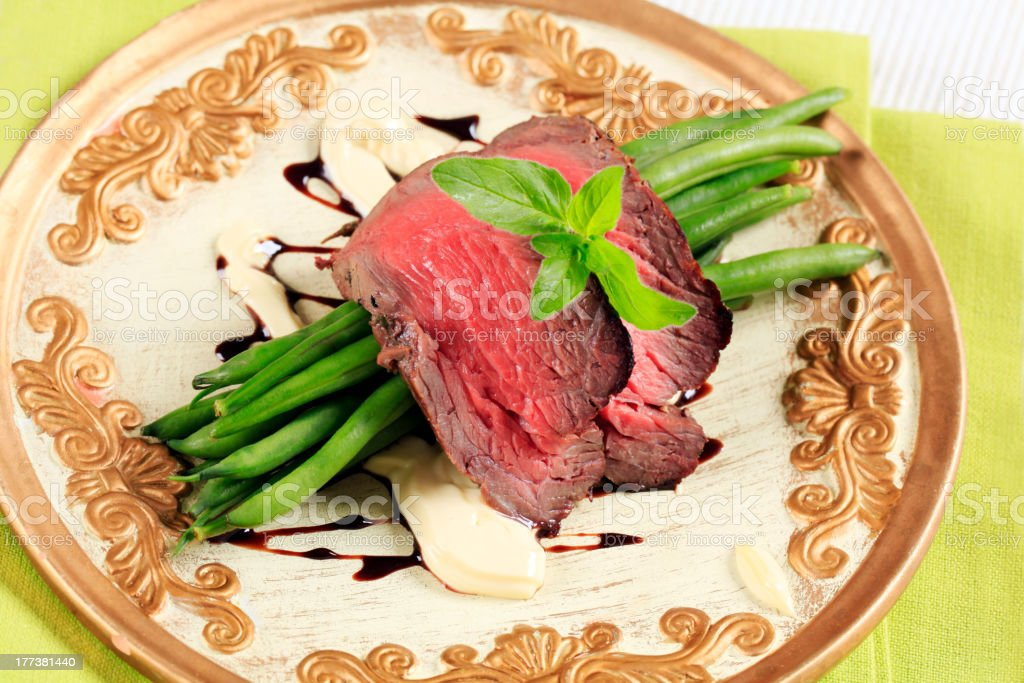 Roast beef and string beans royalty-free stock photo