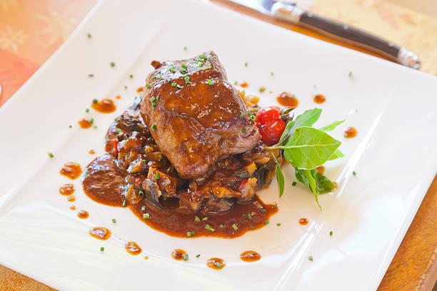 Roast Beef Atop Ratatouille, Cherry Tomato. stock photo