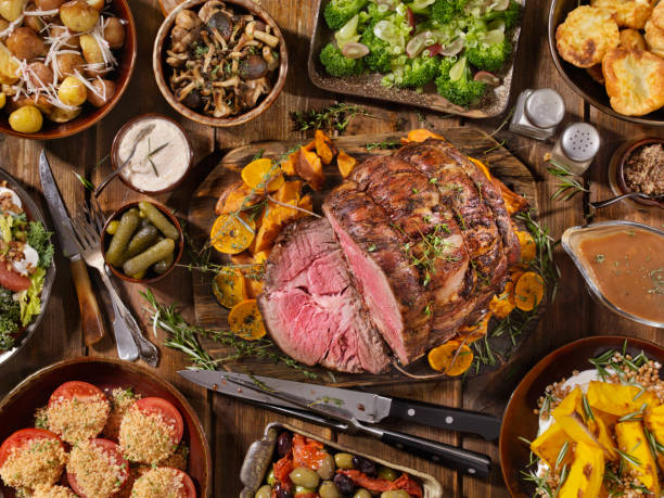 Roast Beef Feast Roast Beef Feast with Yorkshire Pudding, Potatoes, Broccoli, Salad and Gravy roasted prime rib stock pictures, royalty-free photos & images