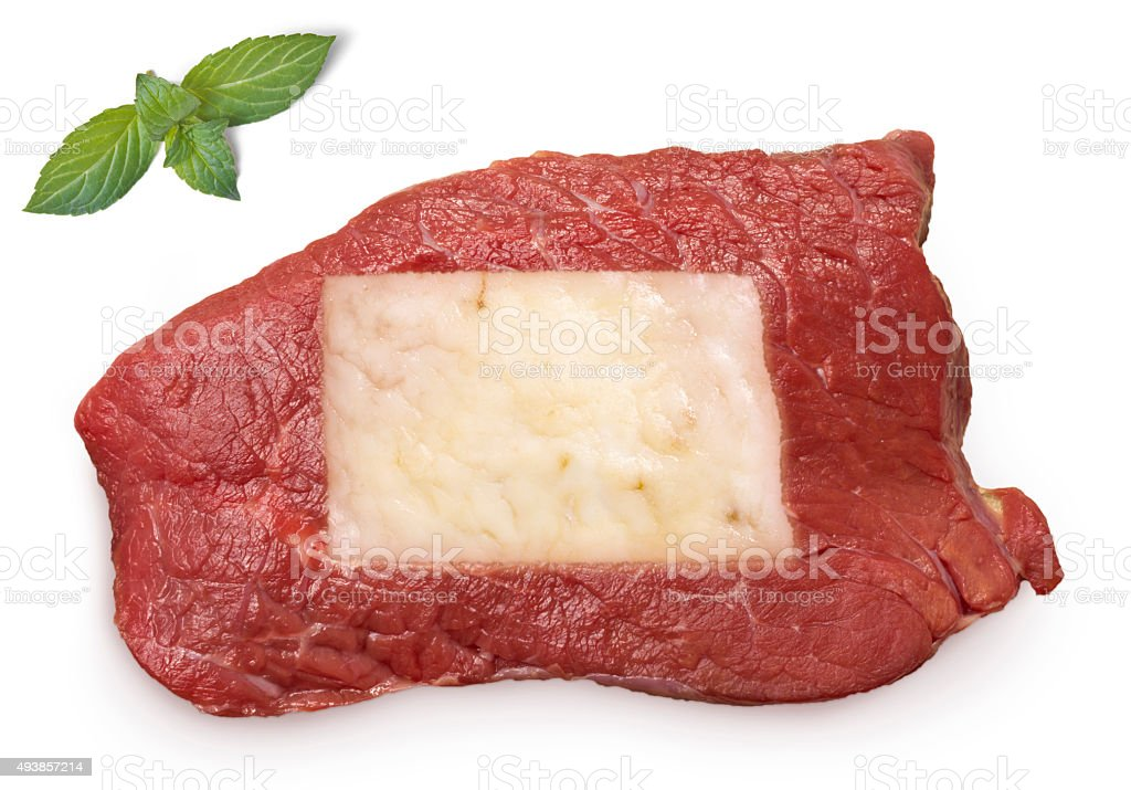 Roast beef meat and fat shaped as North Dakota.(series) stock photo