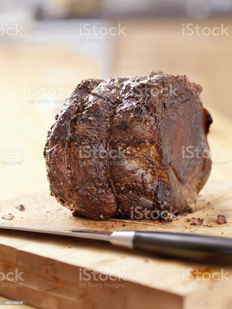 Roast Beef on a Cutting Board royalty-free stock photo