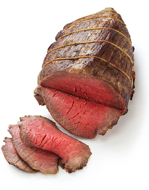 roast beef roast beef isolated on white background roast beef stock pictures, royalty-free photos & images