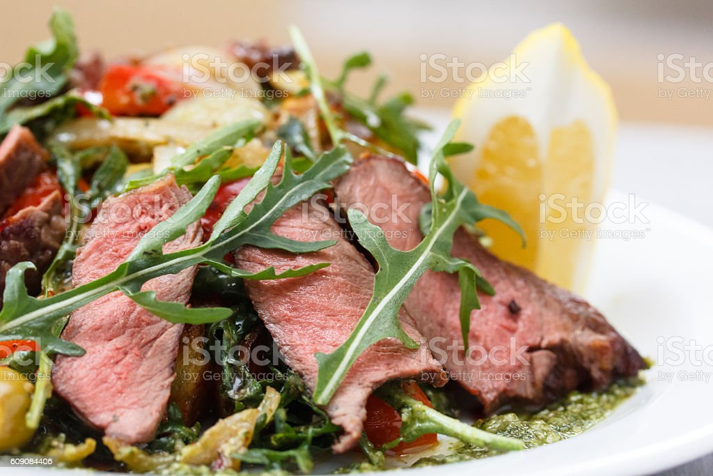 Roast beef with arugula, vegetables stock photo