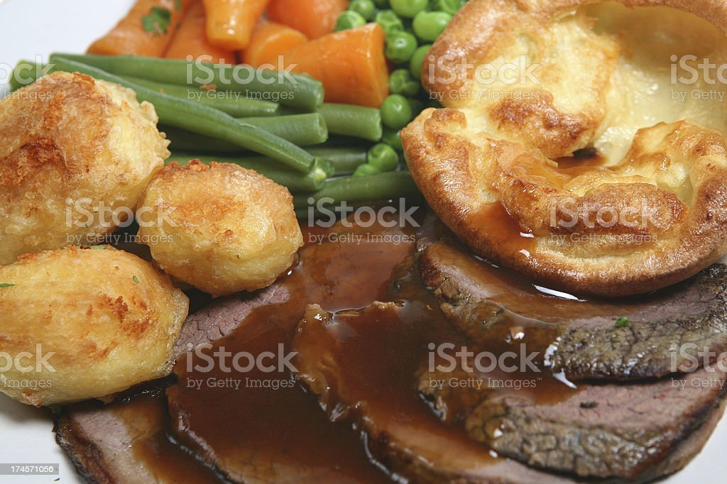 Roast beef with brown gravy and steamed vegetables stock photo