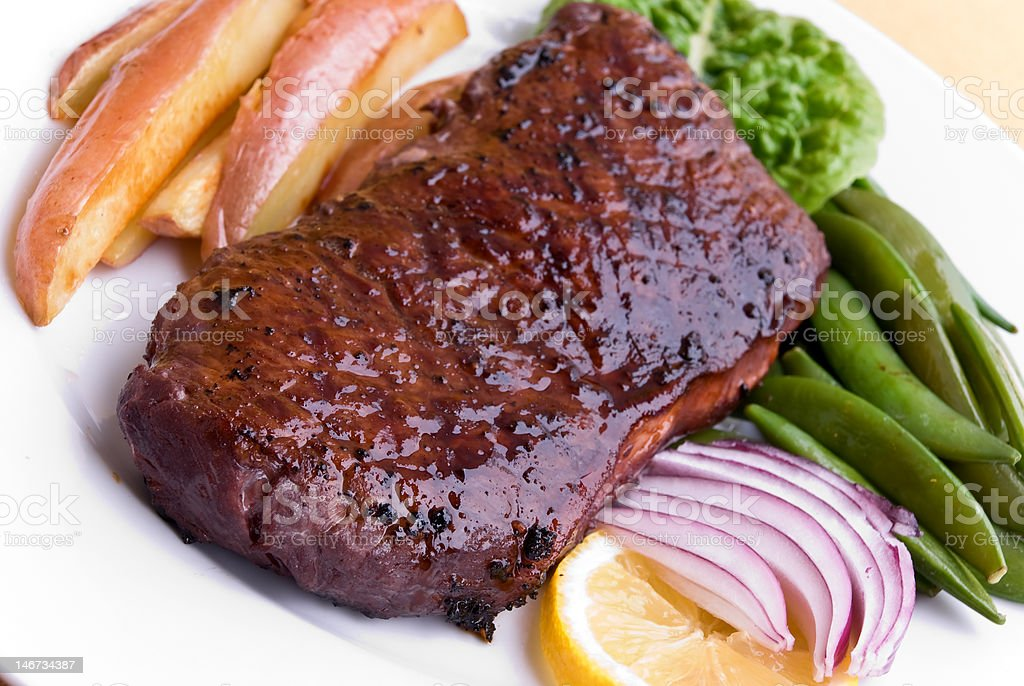 Roast Beef with green Beans and red potatoes,Strip Steak royalty-free stock photo