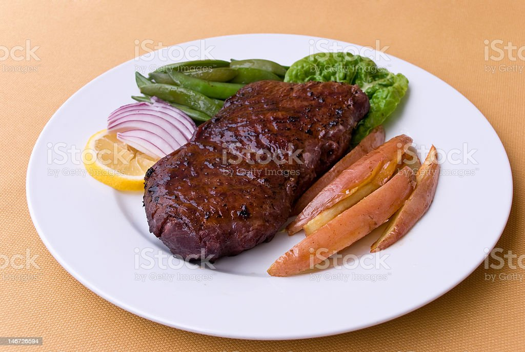 Roast Beef with green Beans .New York Strip Steak royalty-free stock photo