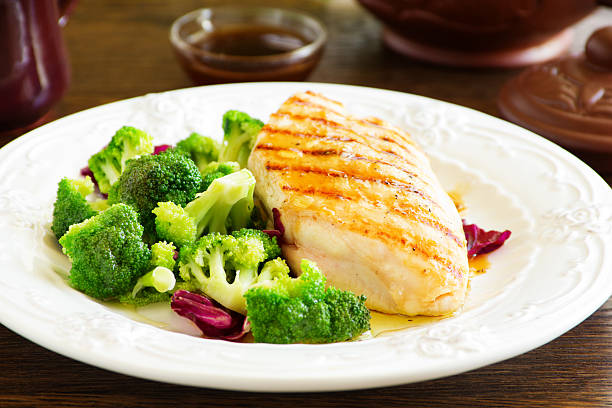 Roast breast grilled with salad with broccoli stock photo