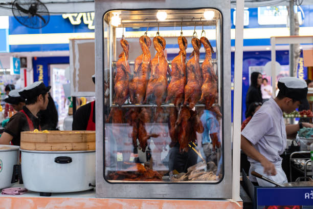 Roast Cantonese ducks  in a windows display of a local market in Thailand stock photo