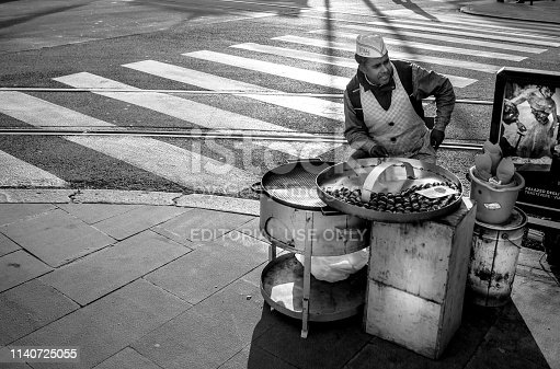 Rome, Italy, Feb 05 - A roast chestnut vendor in the corner of Largo Argentina, a square in the Prati district near the Vatican and St. Peter's Basilica