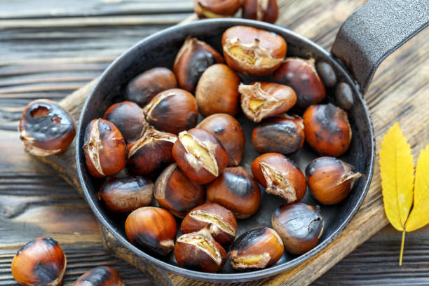 Roast chestnuts in a pan closeup. stock photo