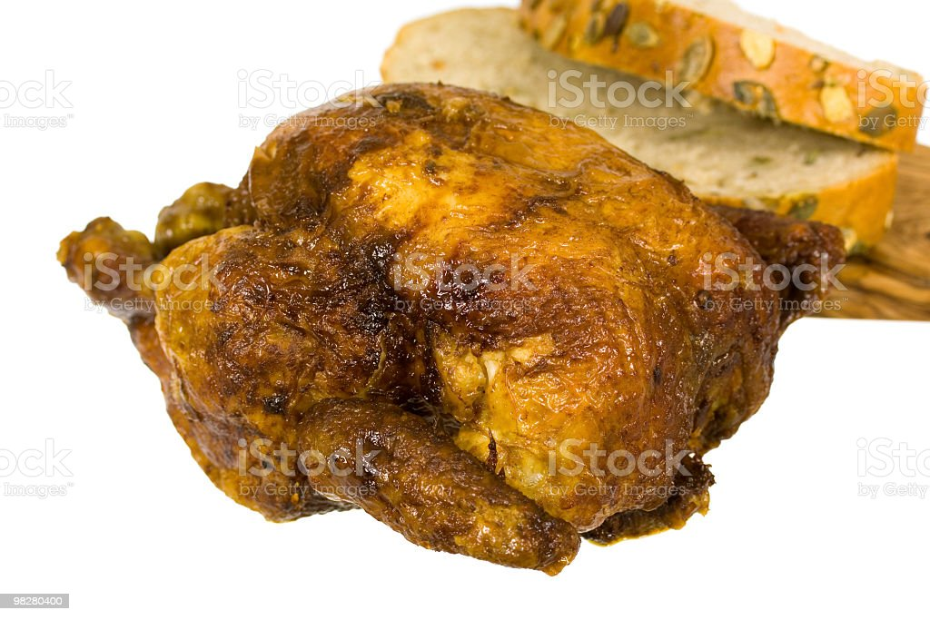roast chickem with slices of bread royalty-free stock photo