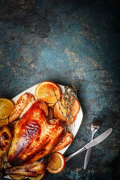 Roast chicken and orange slices served with fork knife picture id500076508?b=1&k=6&m=500076508&s=612x612&w=0&h=nqdcsfxn5q4xnuibzabfgdbnmgbc ahyevx8xk1rfqs=