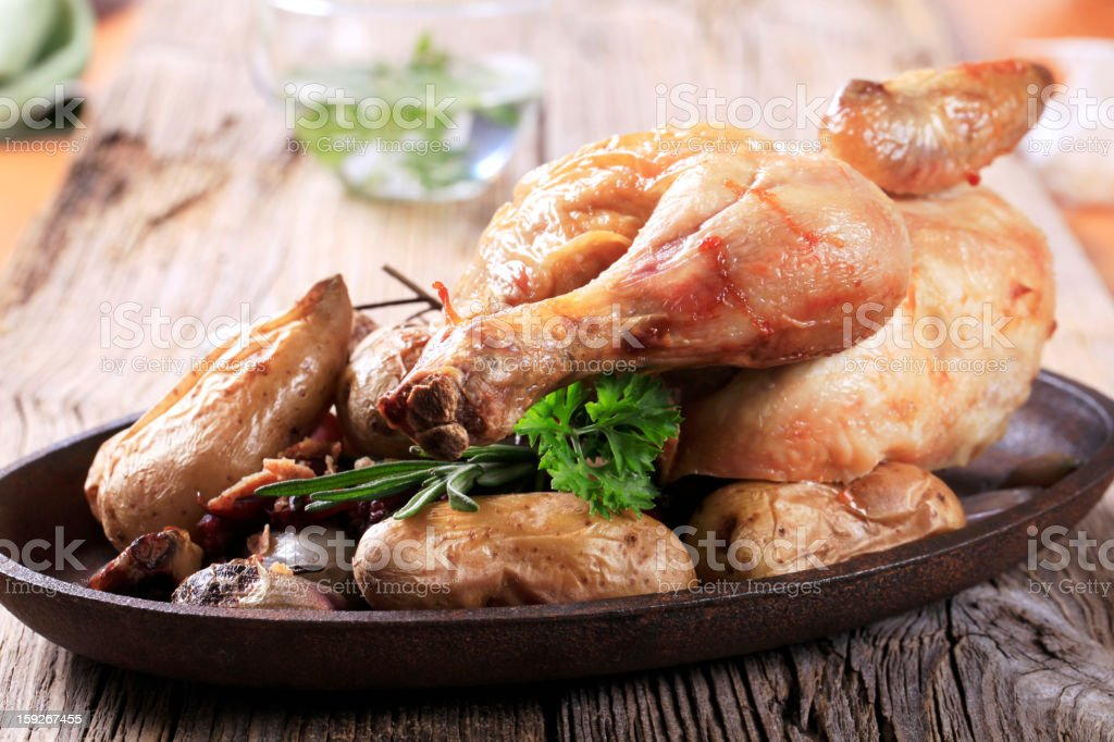 Roast chicken and potatoes royalty-free stock photo