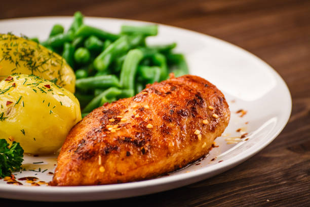 Roast chicken breast, boiled potatoes and vegetables Roast chicken breast, boiled potatoes and vegetables grilled chicken breast stock pictures, royalty-free photos & images