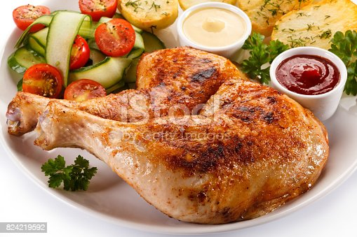 istock Roast chicken leg and vegetables 824219592