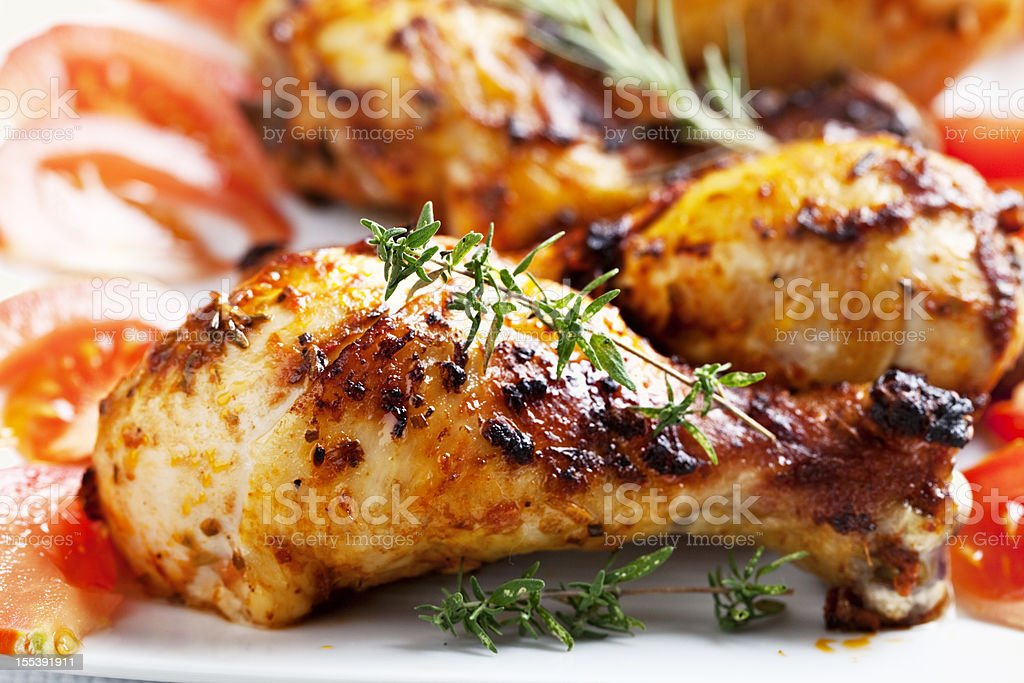 roast chicken legs and rosemary stock photo
