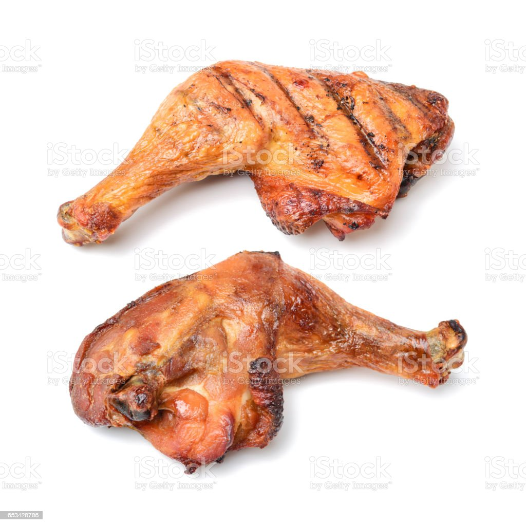 Roast chicken legs  on white background stock photo