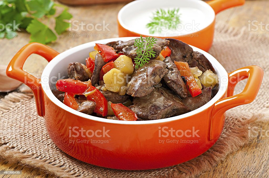 Roast chicken liver with vegetables stock photo