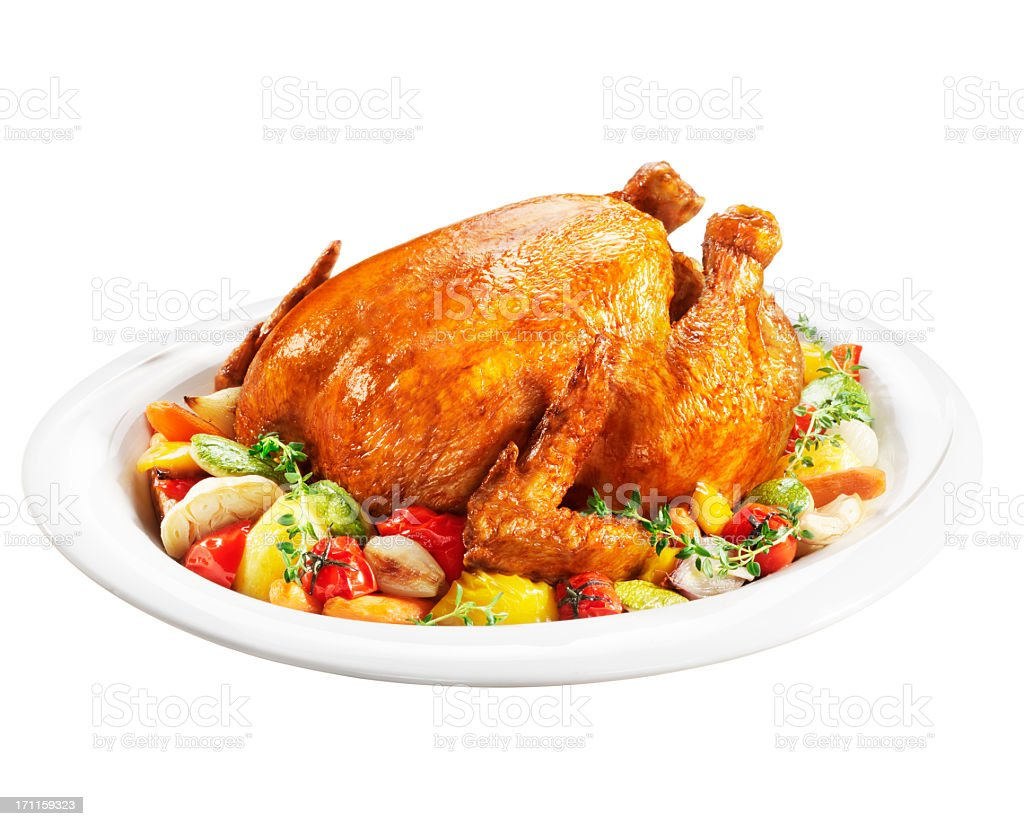 Roast chicken on a plate of vegetables stock photo