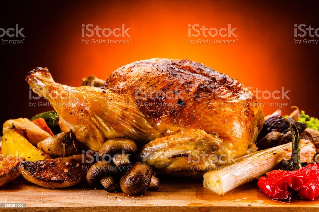 Roast chicken on cutting board stock photo