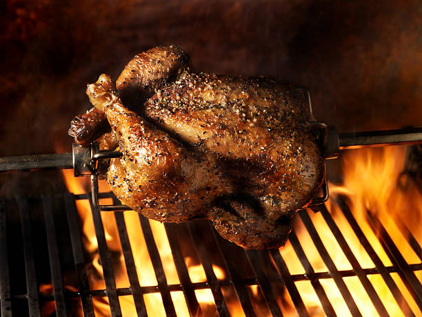 Roast Chicken on the BBQ  spit roasted stock pictures, royalty-free photos & images