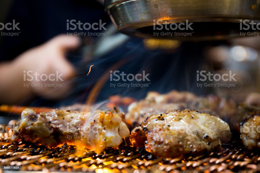 Roast chicken over a hot grill stock photo