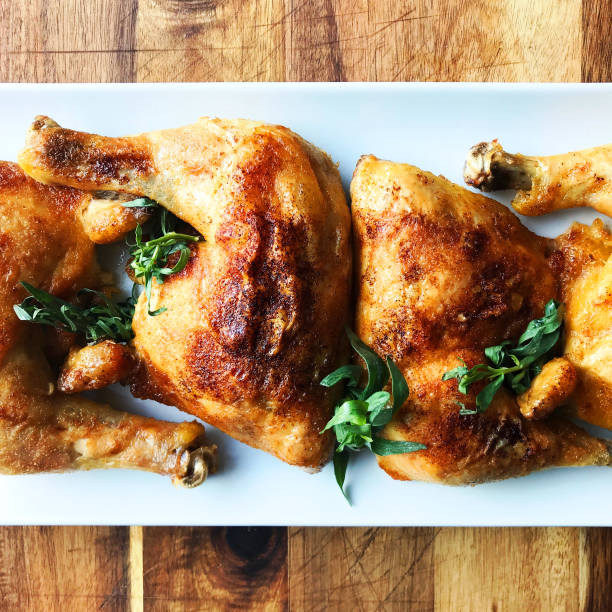 Roast Chicken Quarters Roast Chicken Quarters on White Plate and Cutting Board drumstick stock pictures, royalty-free photos & images