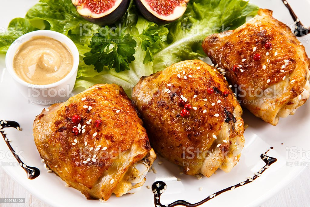 Roast chicken thighs and vegetables stock photo