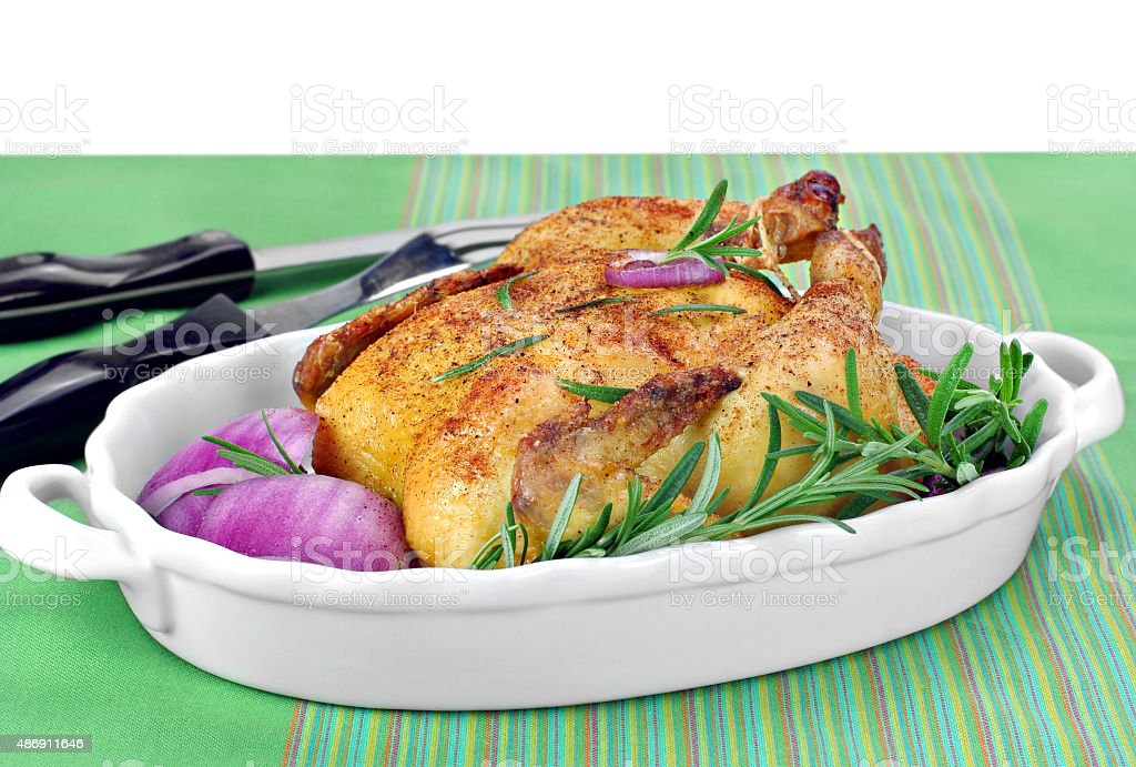 Roast Chicken with fresh rosemary and red onions. stock photo