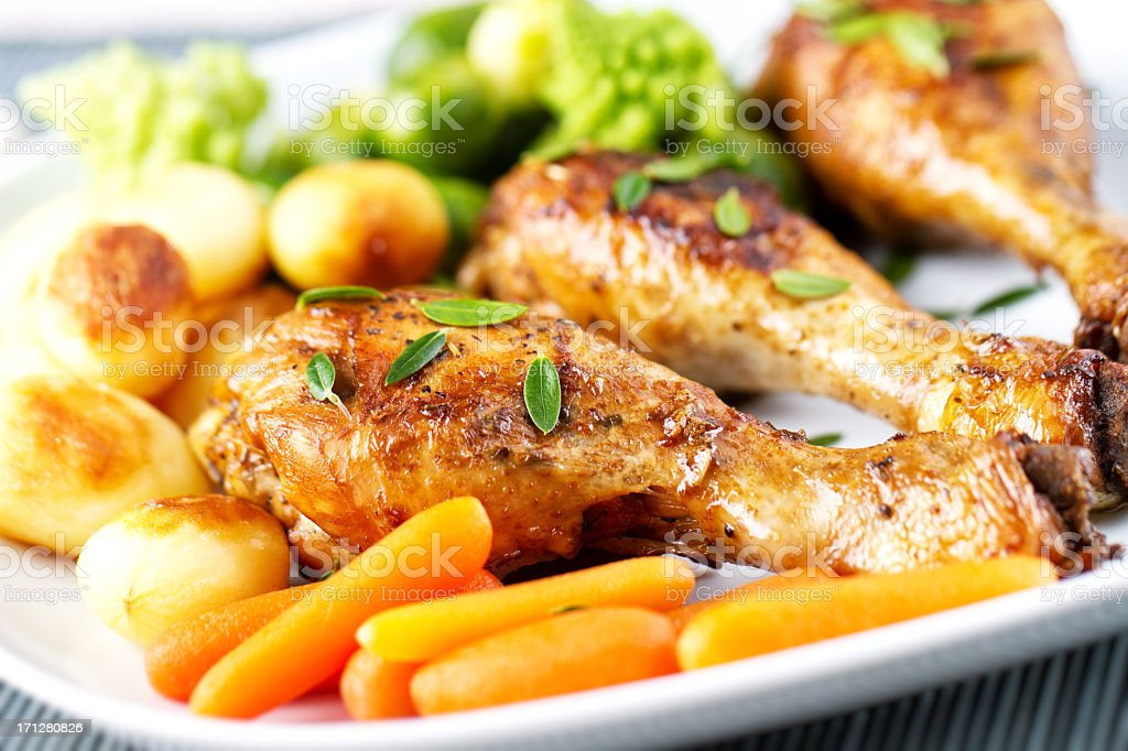 Roast chicken with mixed vegetables stock photo