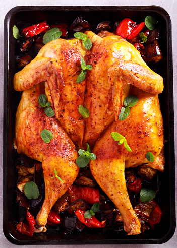 Roast chicken with vegetables and mint