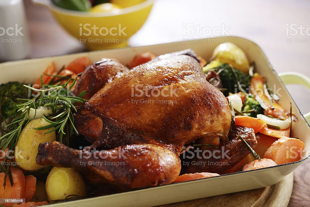 Roast chicken with vegetables stock photo