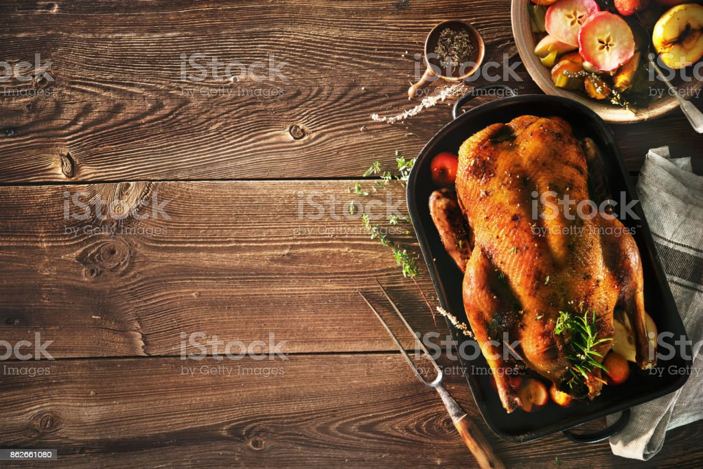 Roast Christmas duck with apples - foto stock