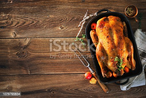 istock Roast Christmas duck with thyme and apples 1029765834
