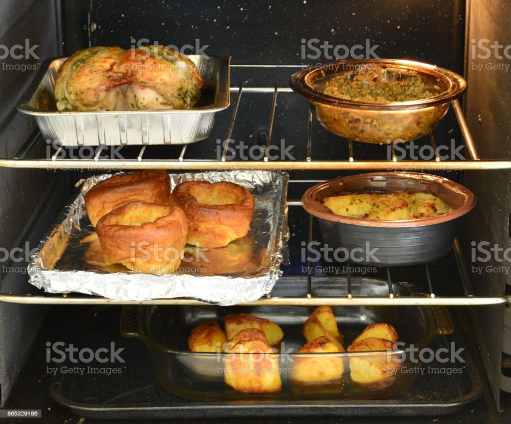 Roast dinner cooking in the oven in England stock photo