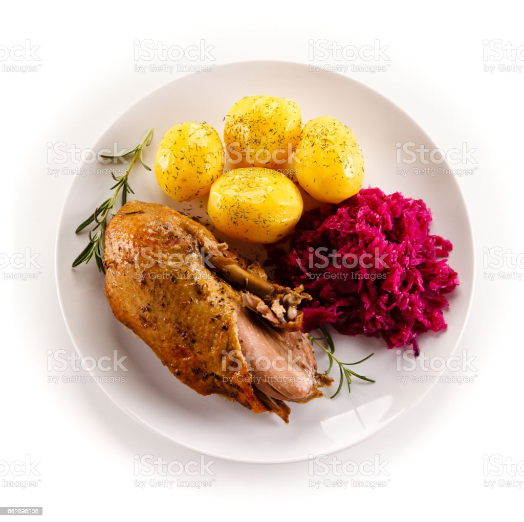 Roast duck fillet and vegetables stock photo