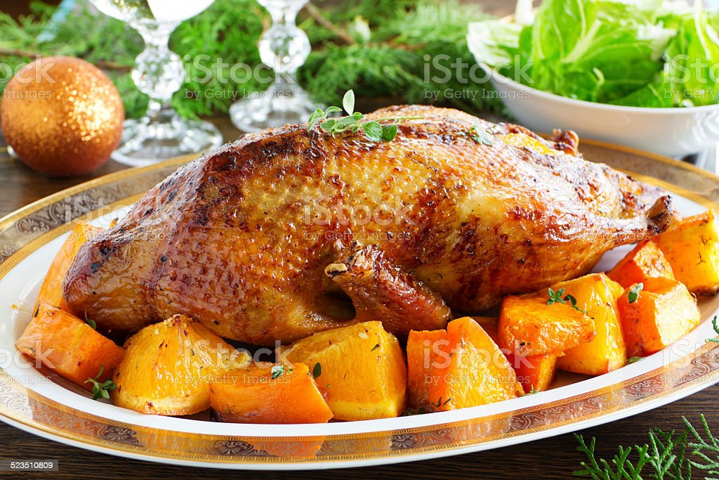 Roast duck with pumpkin and oranges. stock photo