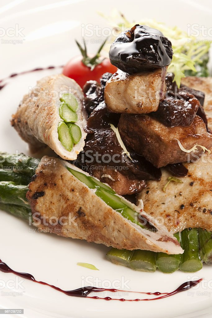 Roast from pork with an asparagus royalty-free stock photo