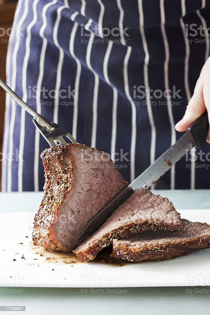 Roast meat is being carved stock photo