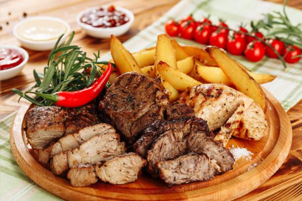 Roast Meat Tenderloin Chili Pepper French Fries stock photo