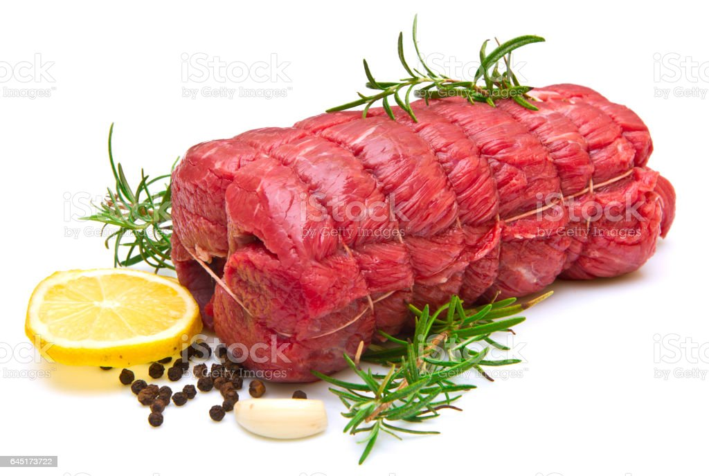roast of beef with rosemary on white stock photo