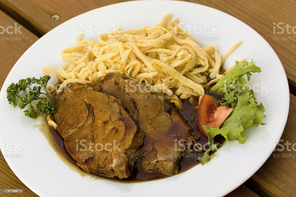 Roast of Pork with Sauce,and spaetzle royalty-free stock photo