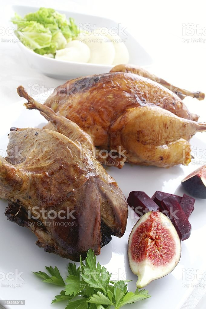 Roast partridge and pheasant stock photo