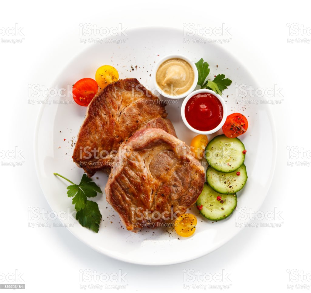Roast pork and vegetables stock photo