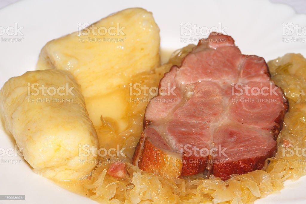 Roast pork, potato dumplings, pickled cabbage stock photo